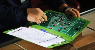 Atletico de Madrid's assistant coach German Burgos looks at a tactics board before the Group A Champions League soccer match between Atletico de Madrid and Juventus at the Vicente Calderon stadium in Madrid, Spain, Wednesday Oct. 1, 2014. (AP Photo/Andres Kudacki)
