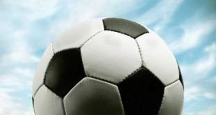 Soccer Ball Resting on Grass --- Image by © Corbis